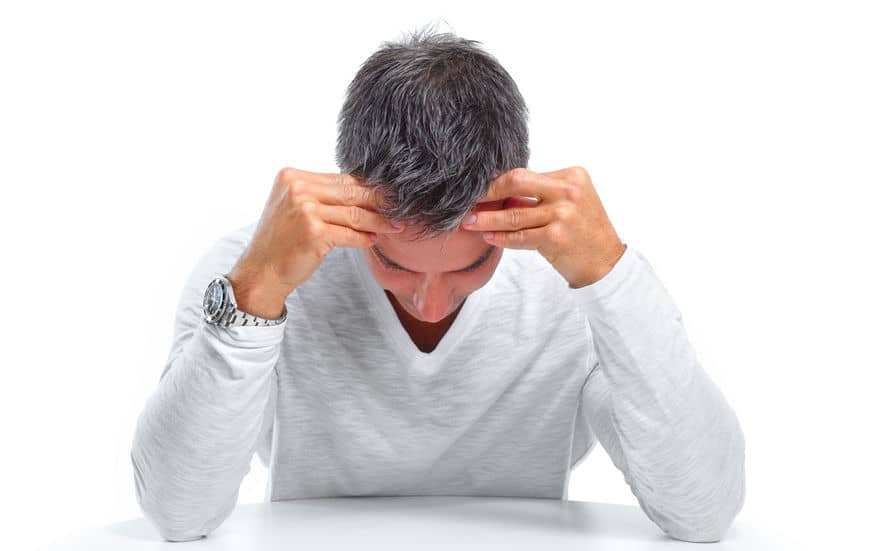 Man suffering from a migraine