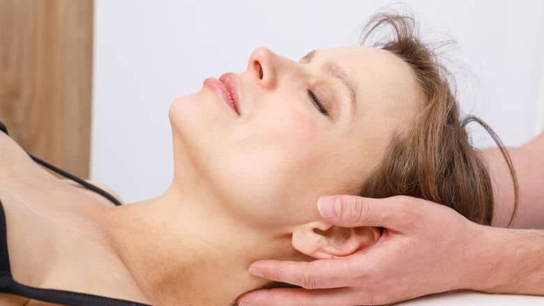 Woman receives a neck adjustment